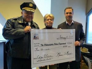 Police Commissioner being presented check